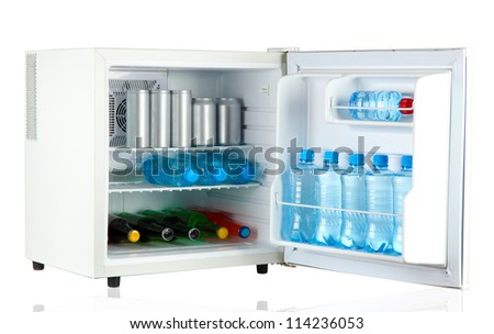 mini fridge full of bottles and jars with various drinks isolated on white - stock photo