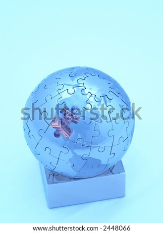 mini globe close up with blue lighting, space for messages - stock photo
