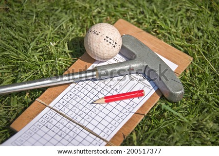 Mini golf equipment on the grass - stock photo