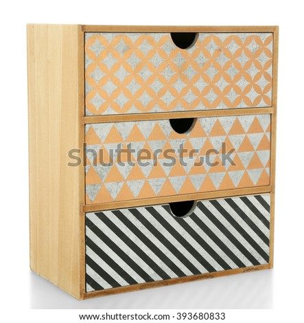 Mini handmade chest of drawers on wooden table background - stock photo