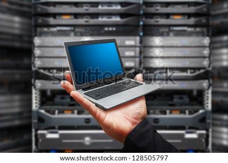 mini laptop in data center room - stock photo