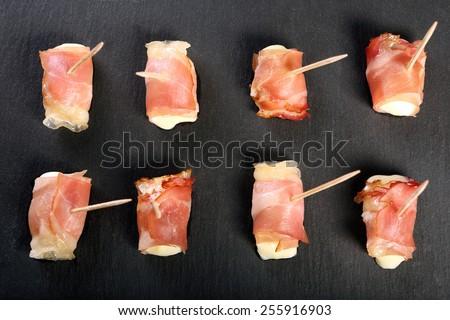 Mini mozzarella wrapped in schwarzwald ham and baked  - stock photo