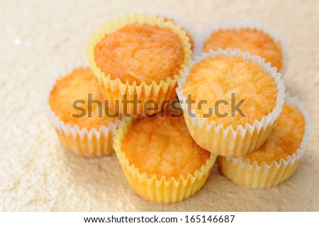 mini muffins  on wooden table - stock photo