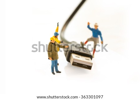 mini people (people model) and usb cable on white background,technology to security and management data concept - stock photo