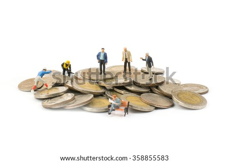mini people (people model) on coin with white background,business concept - stock photo