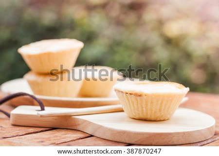 Mini pies on wooden plate, stock photo - stock photo