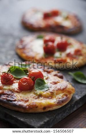 mini pizzas - stock photo