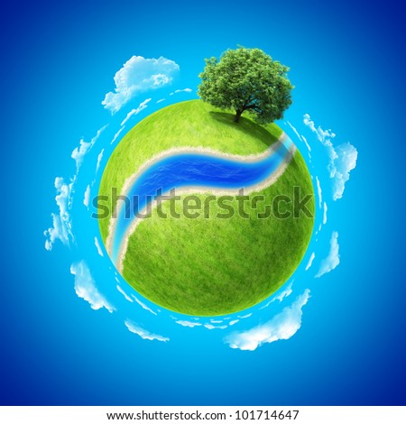Mini planet concept. Empty space and river on fresh green field and sole standing dense tree. Place for your text, product or logo. Earth collection. - stock photo