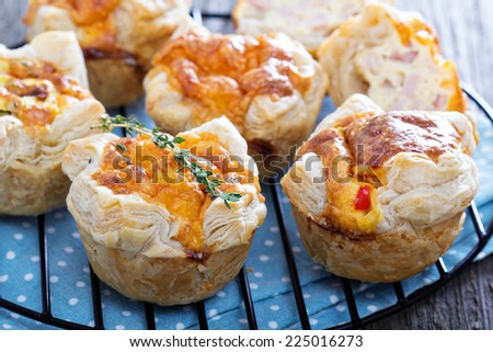 Mini quiche with puff pastry and cheese - stock photo