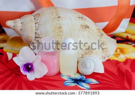 Mini set of bubble bath and shower gel in summer feeling background - stock photo