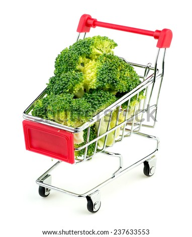 Mini shopping trolley stuffed with juicy green broccoli isolated on white - stock photo