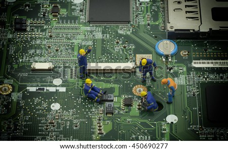 mini technician team still resolve a problem on mainboard - can use to display or montage on product - stock photo