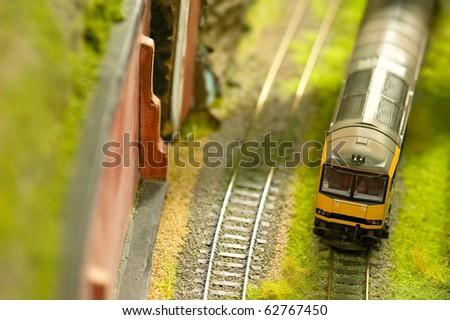 miniature express train on a model railroad set - stock photo