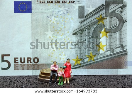 Miniature figure family mother father child - stock photo