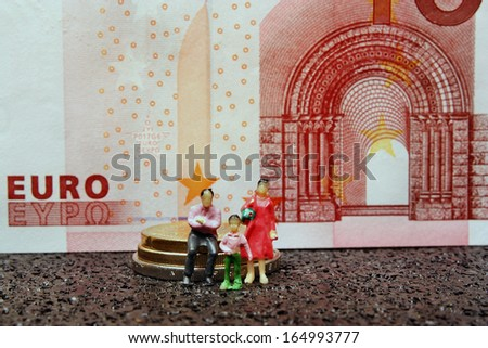Miniature figure family on a background of money - stock photo