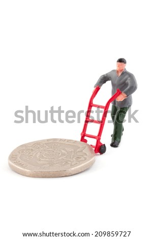 Miniature figure moving a coin over a white background - stock photo