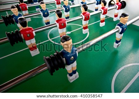 Miniature figures of  players fixed on rods . - stock photo