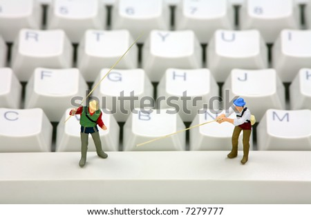 Miniature fisherman representing online email phishing scams. Online phishing and identity theft concept. - stock photo
