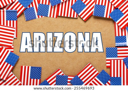 Miniature flags of the United States of America form a border on brown card around the name of the state of Arizona - stock photo