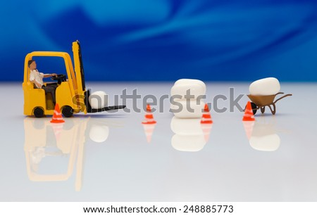 Miniature forklift carrying a candy - stock photo
