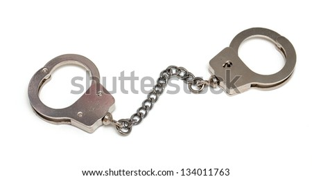 miniature handcuffs isolated on white background - stock photo