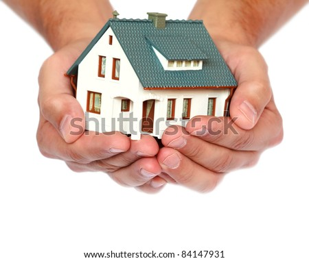 miniature house in hands - stock photo