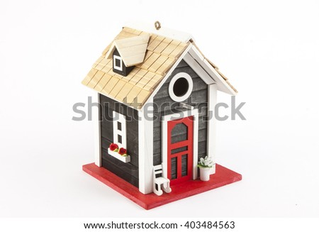 miniature house on a white background - stock photo