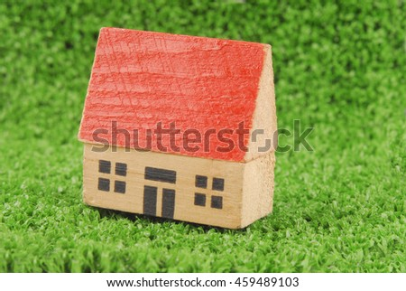 miniature house on green grass concept - stock photo