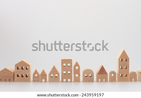 Miniature house on white background - stock photo