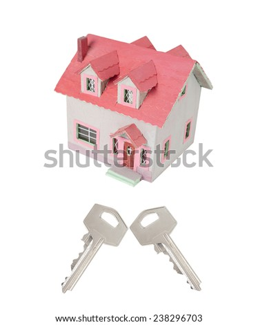 Miniature house with two keys isolated on white background - stock photo