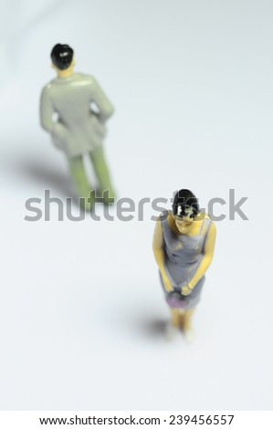 Miniature Man and woman turning back like after an argument - stock photo