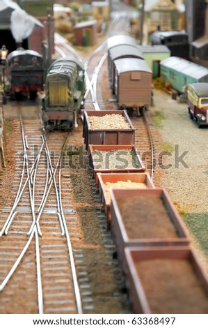miniature model trains and wagons in a freight yard - stock photo