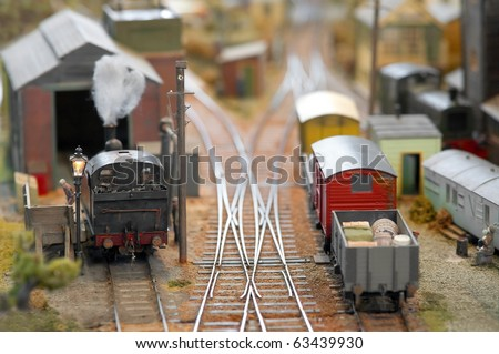 miniature model trains in a freight yard - stock photo