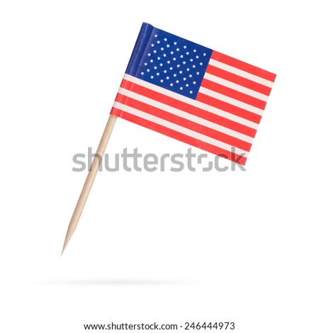 Miniature paper flag USA. Isolated American Flag on white background. With shadow below - stock photo