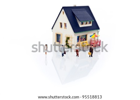 miniature people with house - stock photo