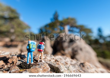 Miniature tourists with backpack. Macro photo - stock photo