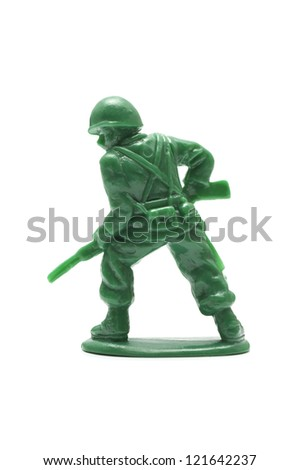 miniature toy soldier on white background, close-up - stock photo