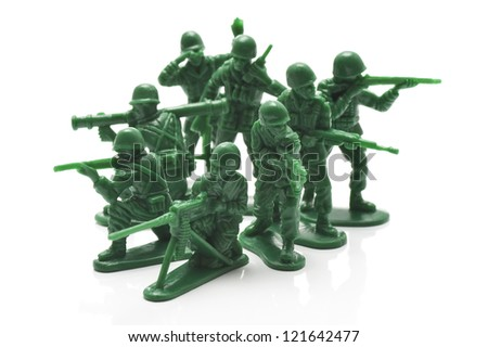 miniature toy soldiers on white background, close-up - stock photo