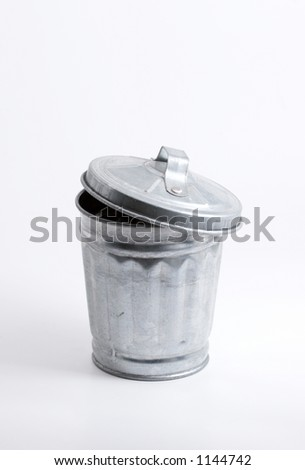 Miniature trash can over white, clipping path - stock photo