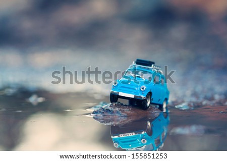 Miniature travelling car with luggage on top. Macro photography - stock photo
