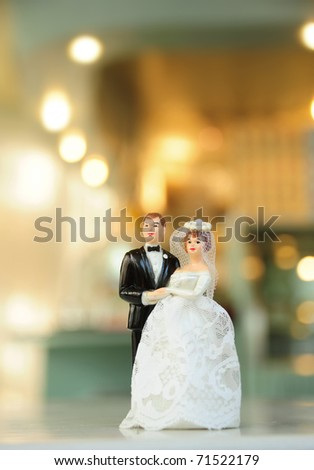 miniature wedding doll with blur background - stock photo