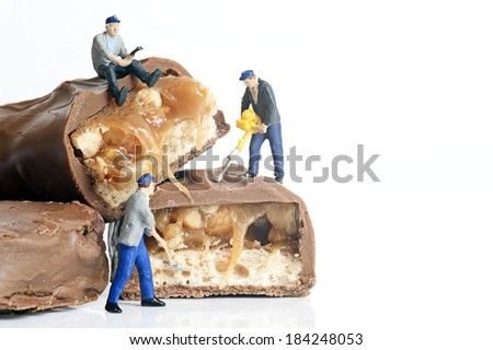 Miniature worker at work - stock photo