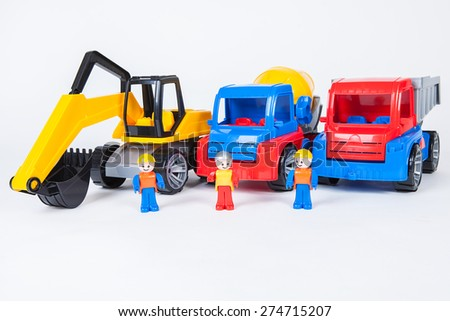 Miniatures of construction workers with building trucks isolated on white background  - stock photo