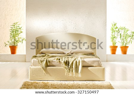 minimal double bed in a modern designed bedroom - stock photo