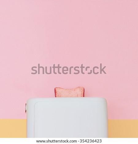 Minimal fashion vanilla style. Single toast in the Toaster - stock photo