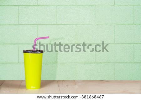 minimalism, cardboard cup with a straw. - stock photo