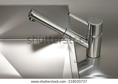 Minimalism design of kitchen faucet and sink - stock photo