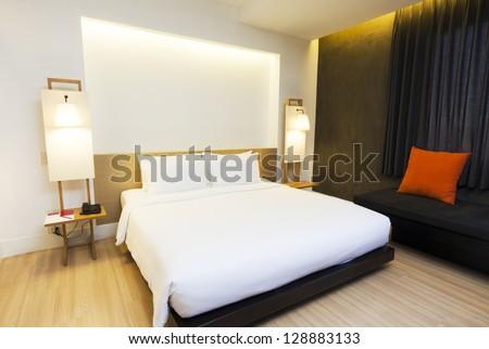 minimalism hotel bedroom in warm tone color. - stock photo