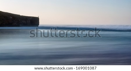 Minimalism in Seascape fisherman at sea. With a fishing rod. - stock photo