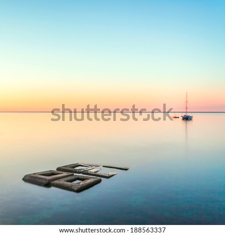 minimalist seascape with rocks & ship - stock photo